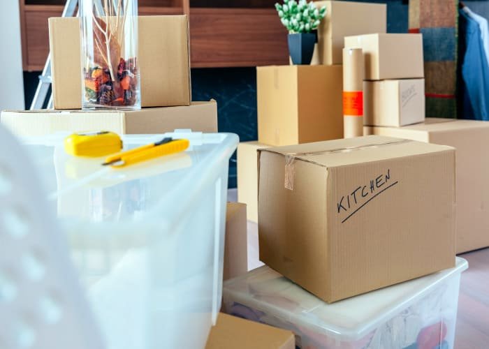 Packing boxes to put into storage in Waukee