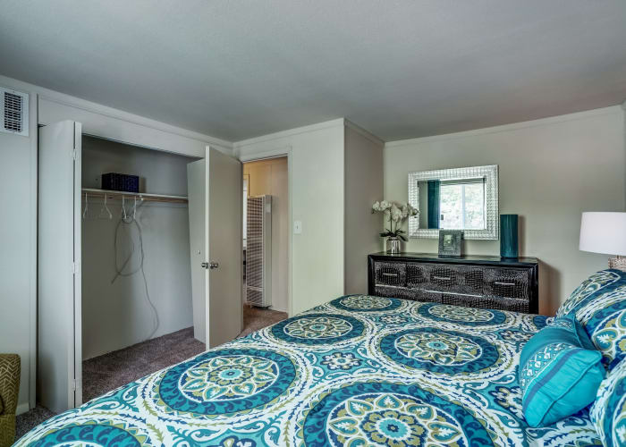 Well-furnished bedroom and closet in model townhome at Avalon Townhomes in Hampton, VA