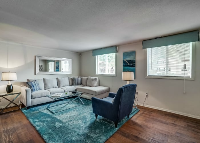 Living room at Avalon Townhomes with hardwood floors and modern decor in Hampton, VA
