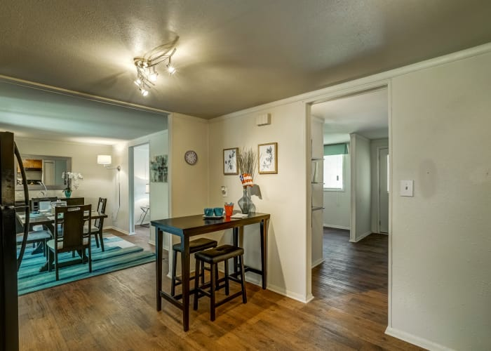 Breakfast nook in kitchen of model townhome with dining area in background at Avalon Townhomes in Hampton, VA