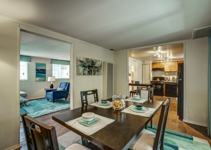 Partial view of living room and kitchen from dining area in model townhome at Avalon Townhomes in Hampton, VA