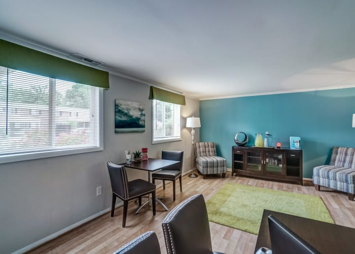 Living room with accent wall in the background at Avalon Townhomes in Hampton, VA