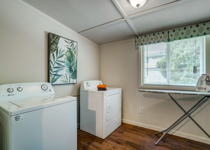 In-unit washer and dryer and ironing board in model townhome at Avalon Townhomes in Hampton, VA