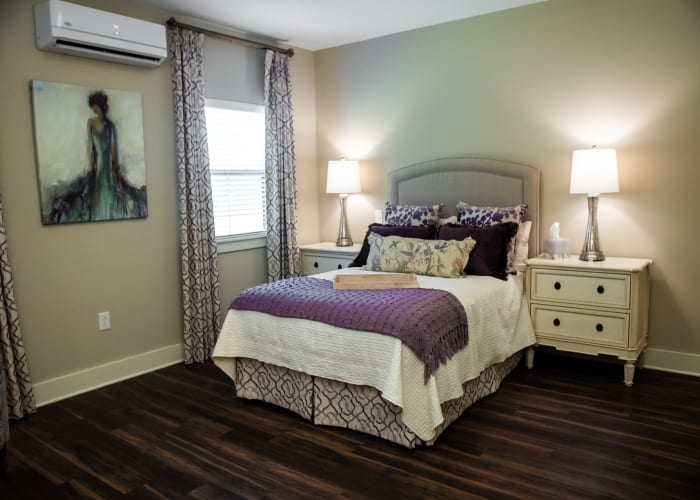 Comfortable resident bedroom with wall art at Westminster Memory Care in Lexington, South Carolina