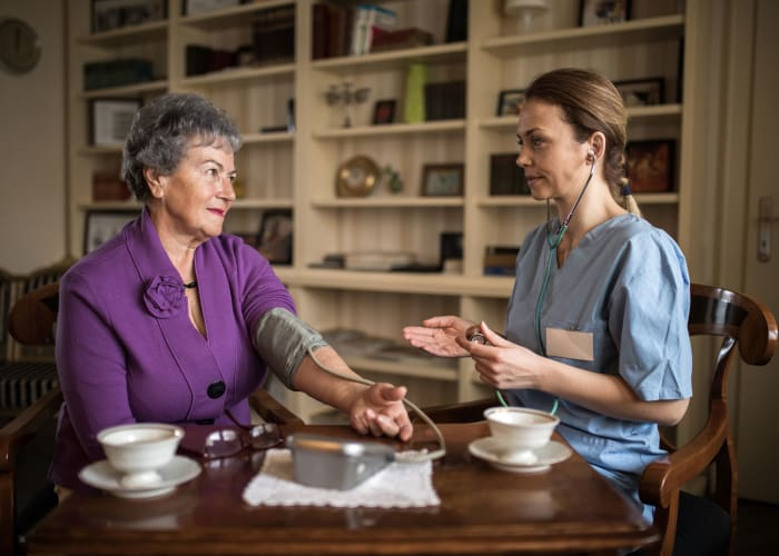 Resident and nurse consulting at Westminster Memory Care in Lexington, South Carolina