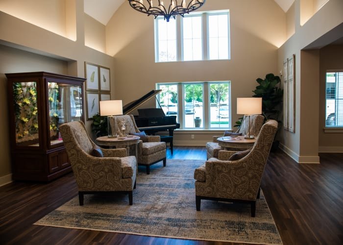Inviting lobby with piano and easy chairs at Westminster Memory Care in Aiken, South Carolina