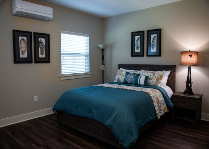 Comfortable resident bedroom with wall art at Westminster Memory Care in Aiken, South Carolina