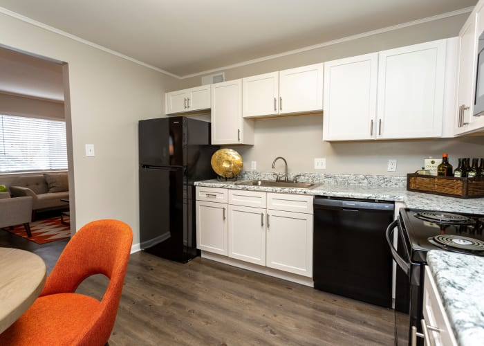 An apartment kitchen with black appliances at Carriage House Apartments in Smyrna, Georgia