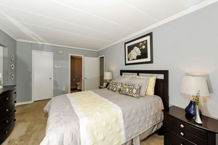 Model bedroom with gray walls at The Reserve at Greenspring in Baltimore, MD
