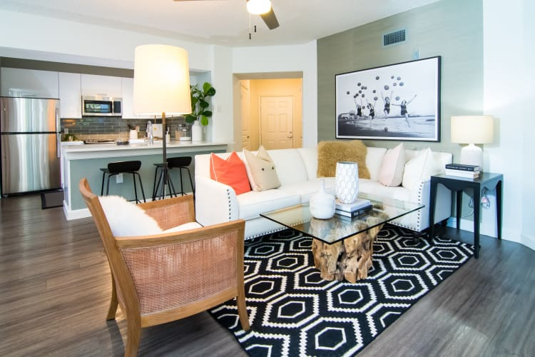 Beautiful living room featuring stylish rug at The Sophia at Abacoa in Jupiter, Florida