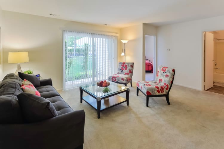The Landings Apartment Homes offers a naturally well-lit living room in Absecon, NJ