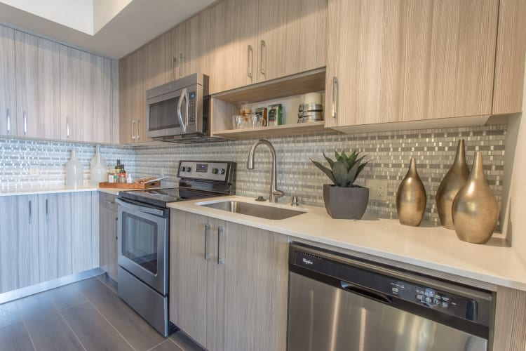 Stainless-steel appliances in a model home's kitchen at Loftin Place Apartments in West Palm Beach, Florida