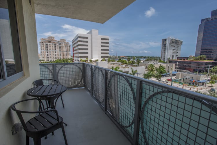 Private balcony outside an apartment home at Loftin Place Apartments in West Palm Beach, Florida