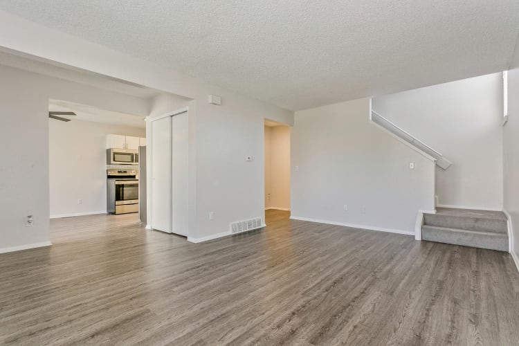 Open-concept floor plan with hardwood floors in a model townhome at Stratus Townhomes in Westminster, Colorado