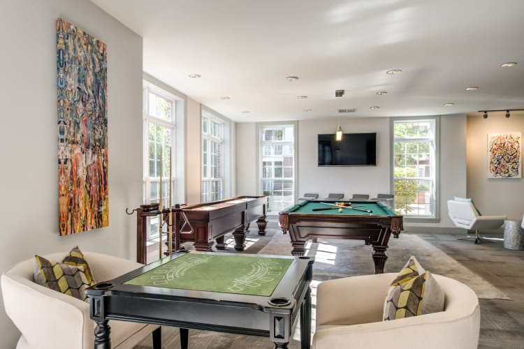 Game room with billiards table and more in the resident clubhouse at The Lena Luxury Residences in Raritan, New Jersey