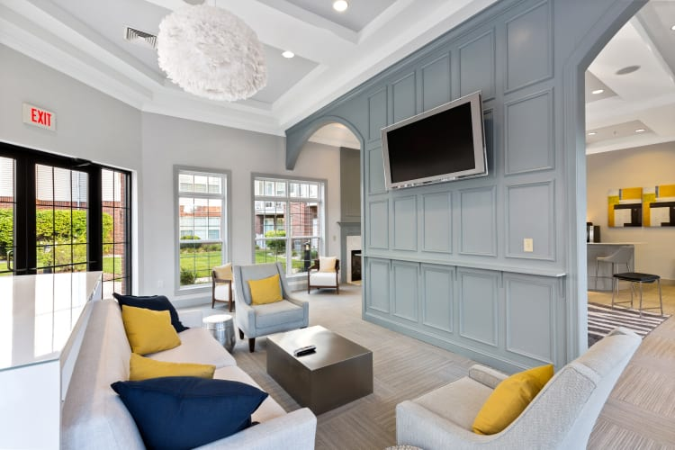 Resident lounge with flatscreen TV in the clubhouse at The Lena Luxury Residences in Raritan, New Jersey
