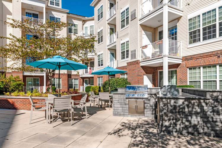 Barbecue area with gas grills in the courtyard at The Lena Luxury Residences in Raritan, New Jersey