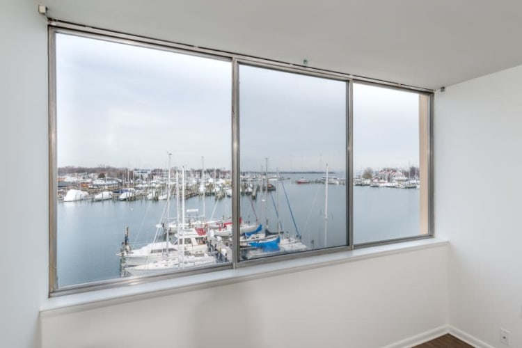 View of the bay from an apartment home's bedroom window at Watergate Pointe in Annapolis, Maryland