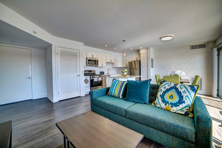 Retro-modern decor in a model home's living area at Watergate Pointe in Annapolis, Maryland