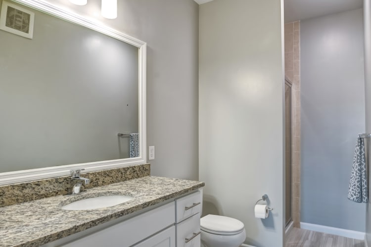 A bathroom with walk-in shower at Harbor Pointe in Bayonne, New Jersey