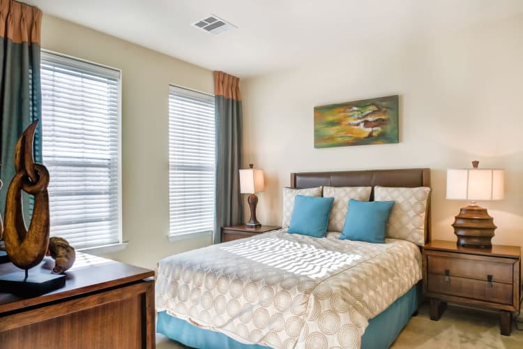 Large master bedroom with two windows for ample natural lighting at Harbor Pointe in Bayonne, New Jersey