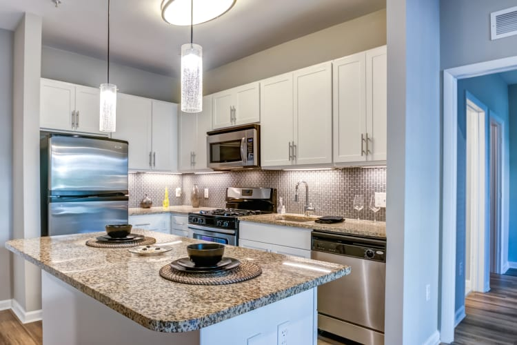 Kitchen with ample lighting at Harbor Pointe in Bayonne, New Jersey