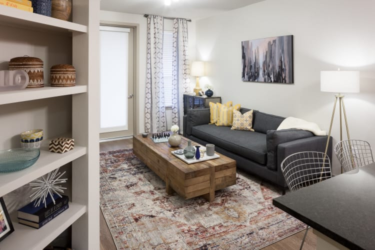 Well-decorated living area with built-in shelving in a model home at Regatta Sloan's Lake in Denver, Colorado