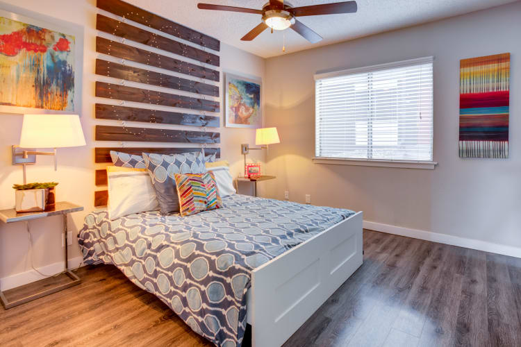 Large master bedroom with a ceiling fan at Array Apartments in Austin, Texas