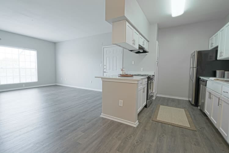 Open-concept layout with beautiful hardwood flooring in an apartment home at Azure Apartments in Corpus Christi, Texas