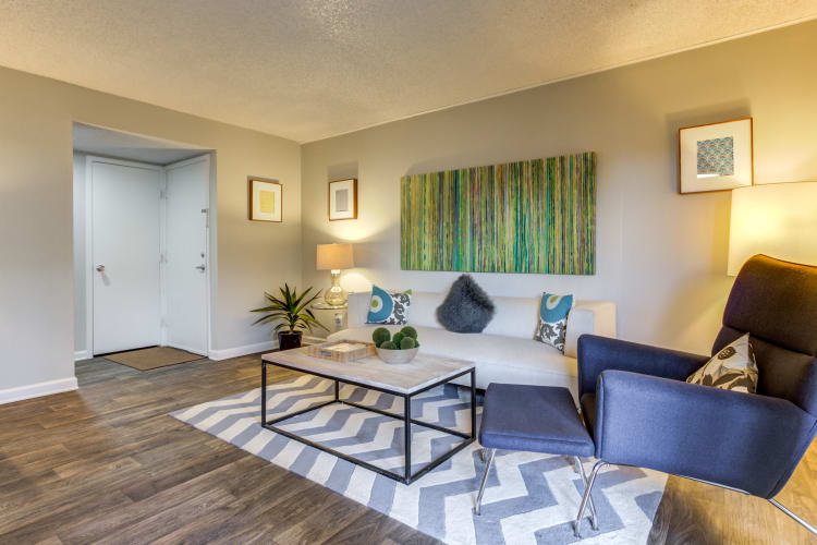 Comfortably decorated living area in an open-concept floor plan of a model home at The Ranch at Bear Creek Apartments & Townhomes in Lakewood, Colorado