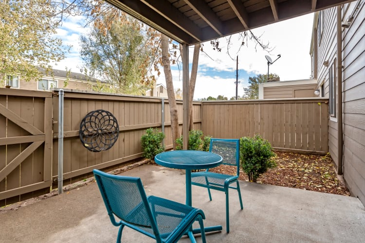 Spacious private patio outside a model home at The Ranch at Bear Creek Apartments & Townhomes in Lakewood, Colorado