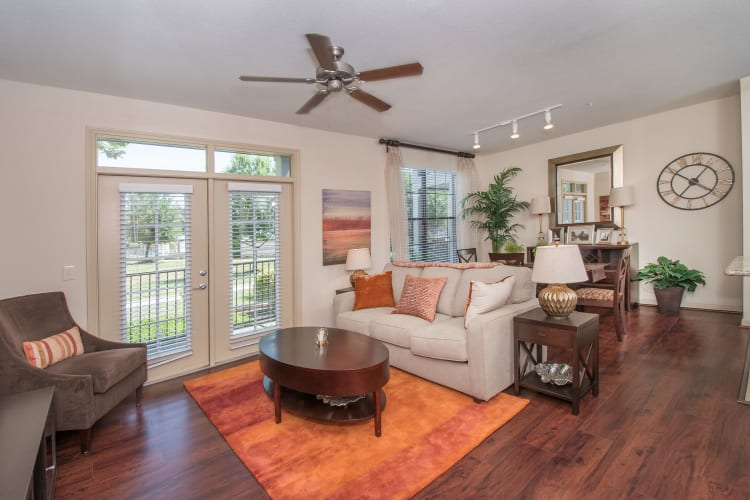 Living room with wood-style  flooring and a ceiling fan at Villas Tech Ridge in Pflugerville, Texas