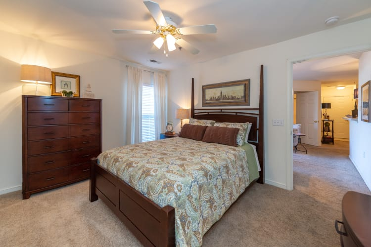 Large master bedroom with a ceiling fan at The Overlook at Stonemill in Lynchburg, Virginia
