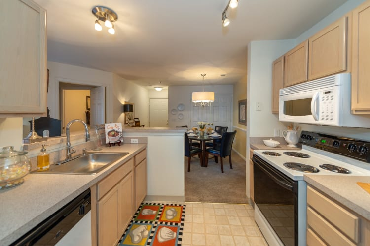 Kitchen with plenty of counter-space and white appliances at The Overlook at Stonemill in Lynchburg, Virginia