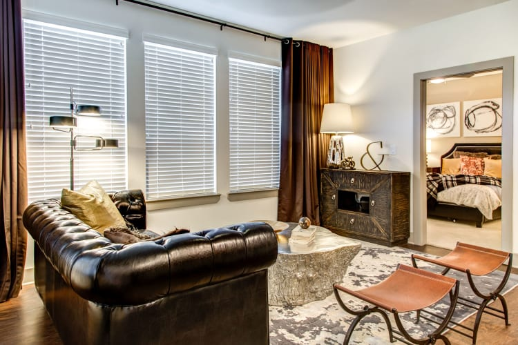 Well-furnished model home's living area at Waterford Trails in Spring, Texas