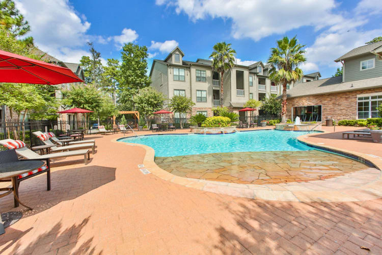 Resort-style swimming pool at Stone Creek at The Woodlands in The Woodlands, Texas