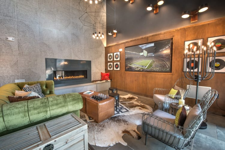 Clubhouse with large tv on the wall at Mercantile River District in Fort Worth, Texas