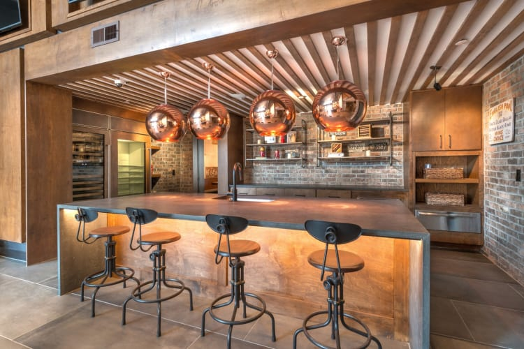 Bar stools in the clubhouse area by the pool at Mercantile River District in Fort Worth, Texas