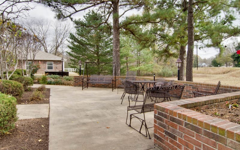 Outdoor patio with chairs at Southern Oaks in Henderson, Tennessee