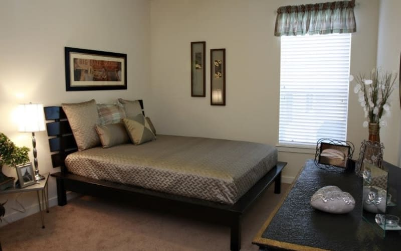 Enjoy a cozy bedroom at The Marquis Apartment Homes in New Orleans, Louisiana