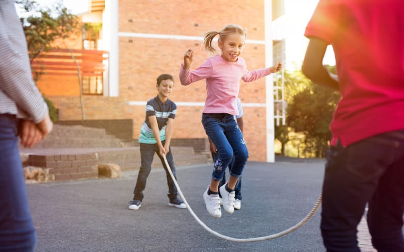 Kids jumping rope at Ellsworth Apartments in Bridgeport, Connecticut