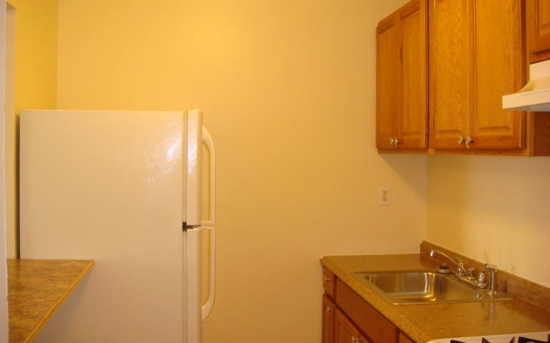 Kitchen sink and appliances in apartment at Ellsworth Apartments in Bridgeport, Connecticut