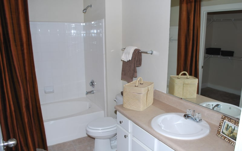An apartment bathroom at Providence Mockingbird Towers in Dallas, Texas
