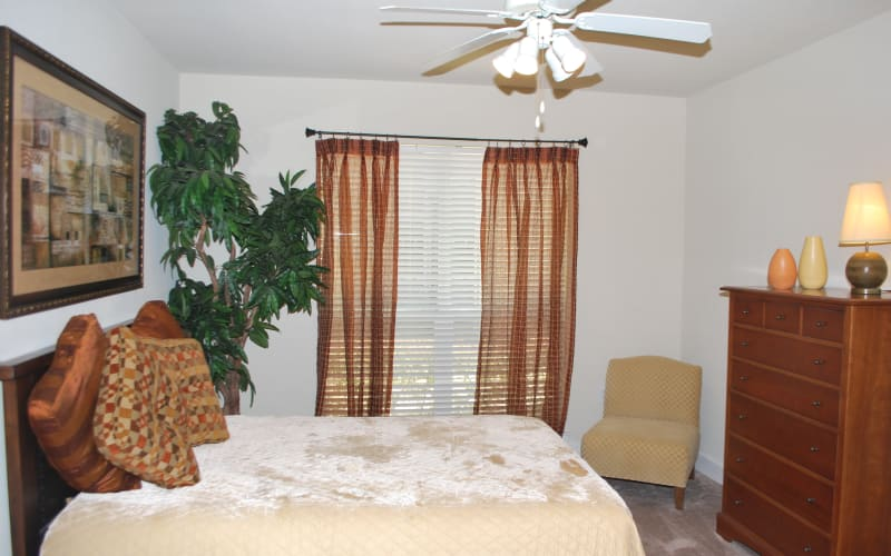 A spacious apartment bedroom at Providence Mockingbird Towers in Dallas, Texas