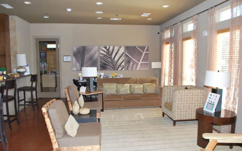 A lounge area for residents at Providence Mockingbird Towers in Dallas, Texas
