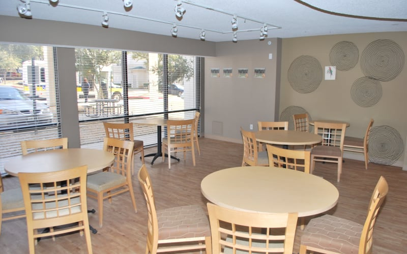 Community tables at Providence Mockingbird Towers in Dallas, Texas