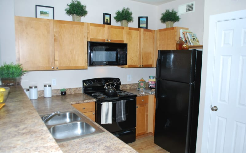 Appliances in an apartment kitchen at Providence Mockingbird Towers in Dallas, Texas