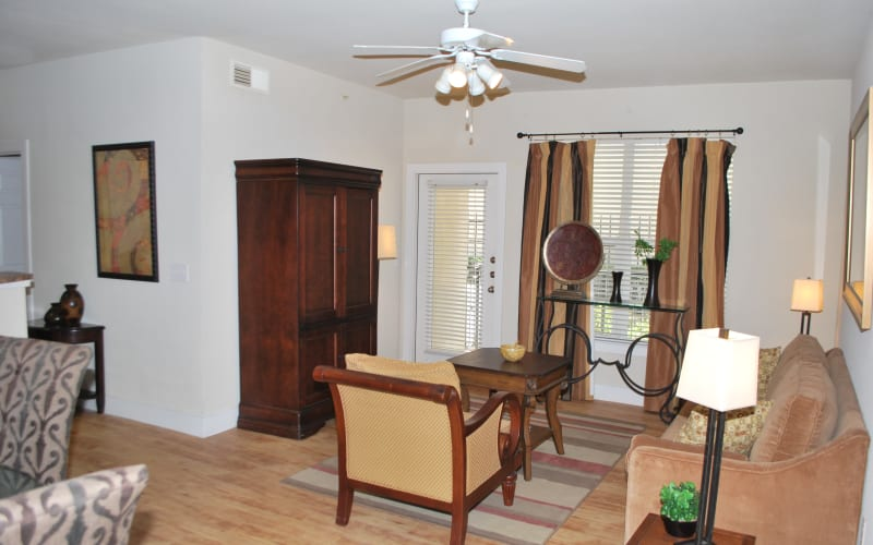 An apartment dining room and living room at Providence Mockingbird Towers in Dallas, Texas