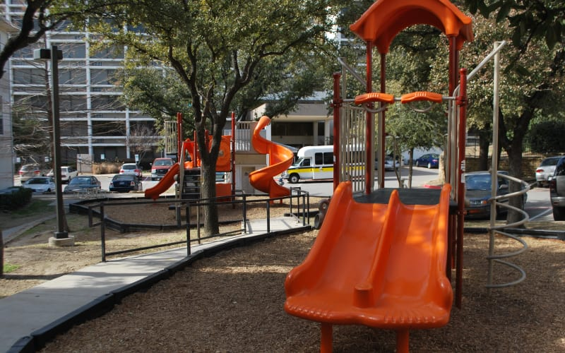 The community playground at Providence Mockingbird Towers in Dallas, Texas