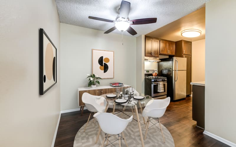 Spacious dining room and kitchen with hardwood-style floors at Kendallwood Apartments in Whittier, California